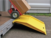 eagle polyurethane dock plate in use with dolly carrying boxes