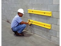 Wall protectors being installed